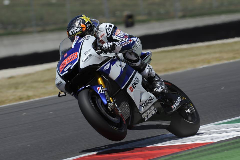 Forces Motogp Motorcycles Lift Front Wheel While Exiting Curve