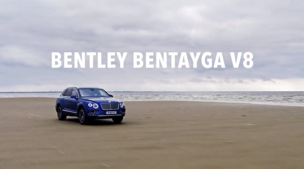 Bentley Bentayga driving on sand